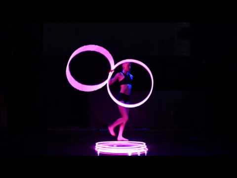 Girl Performs with LED Hula Hoops