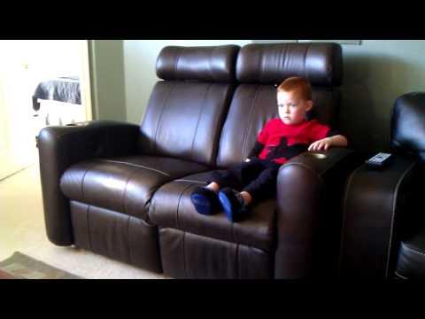 My son, Luke, on the D-BOX chair.
