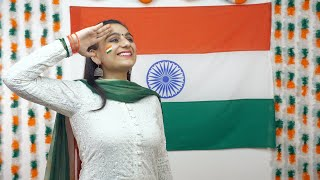Young Indian girl looking up in the sky and saluting Indian tricolor flag - celebrating Independence Day