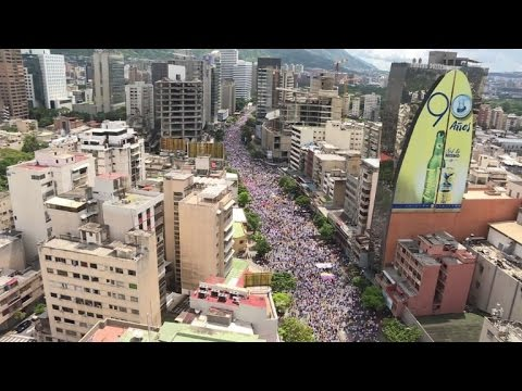 Thousands of anti-government protesters march in Caracas