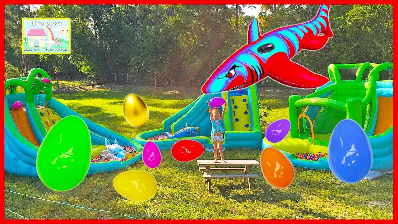 Huge Surprise Eggs Hunt On 3 Giant Inflatable Water Slides