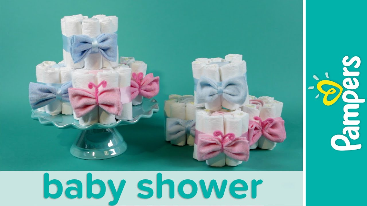 How to make mini diaper cakes pampers gender reveal baby for Baby shower diaper decoration