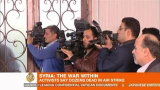Activists: At least 90 killed in air strike on Syria bakery