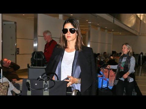 Alessandra Ambrosio Pushes Own Luggage Headed To Paris Fashion Week