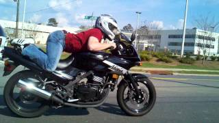 Man humps motorcycle doing trick