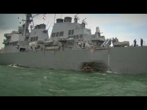 Search underway for ten US sailors missing...