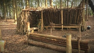 Camping in a Debris Shelter (Bushcraft) - Lanterns, Log Bench, Deer Hide Beds