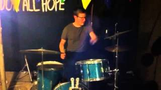 Nude man plays drum solo fully clothed