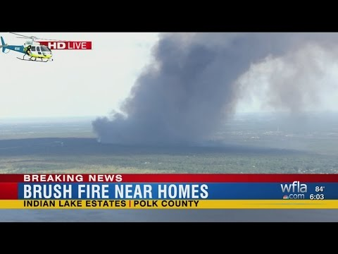 Brush fire approaches homes at Indian Lake Estates
