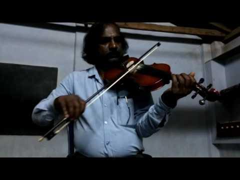 suruma yezhuthiya mizhikale...  violin played by vattappara Vijayakumar