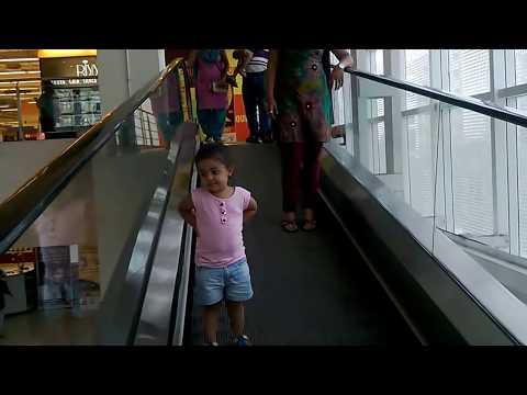 Using escalator herself