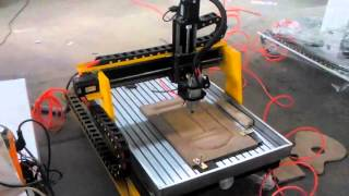mini cnc router with desktop working on wood 3d embossment work