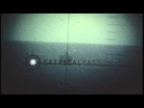A periscope view of the explosion on a Japanese submarine after being hit by a to...HD Stock Footage