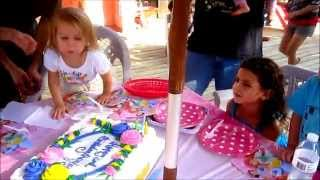 She can't blow out the candles; Parents to the rescue