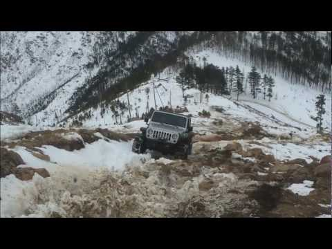 Supercharged Jeep Rubicon Testing All Four Snow Chains In Rough Terrain