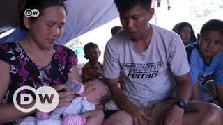 Video Indonesian city of Palu in desperate need of aid following earthquake and tsunami  | DW English download MP3, 3GP, MP4, WEBM, AVI, FLV November 2018