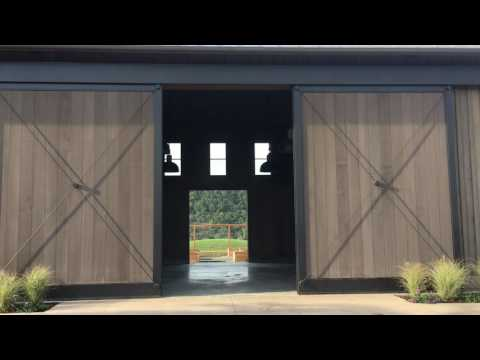 Crown Industrial Projects: Bottom Rolling Top Guided Electrically Operated Bi-parting Sliding Doors