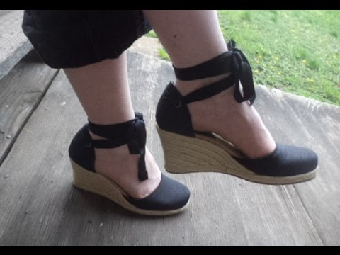 Walking In Wobbly Espadrille Sandels Through Grass wedge shoes down steps woman walks high heels