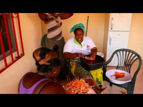 Impromptu song and dance by Sierra Leone woman preparing food for wedding in Gambia