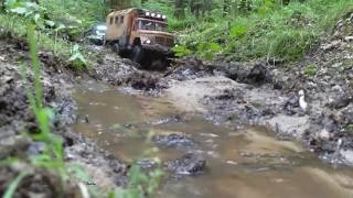 rc axial scx10 kraz 255 zil 131 and jeep wrangler going up stream