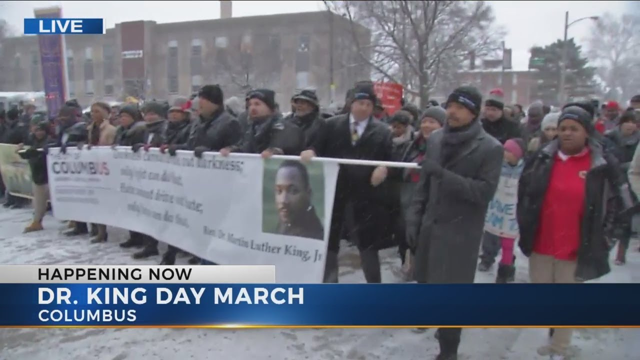 Take part in a march to honor Martin Luther King, Jr.