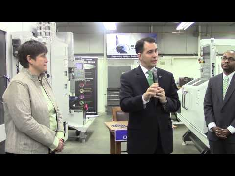 Governor Scott Walker signs legislation at Blackhawk Technical College