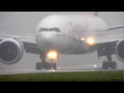 Emirates 777 landing in heavy rain BHX