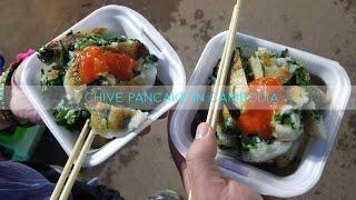 Eating chive pancake in Cambodia