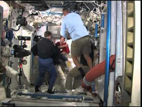 STS-135 - Atlantis - ISS Crew Hatch Opening and Welcome Ceremony +.asx