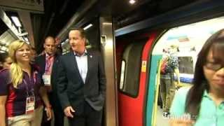 Prime Minister David Cameron rides London Underground to Olympic Park