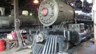 California Gold Country Steam Locomotive Brakeman Side Steaming in Roundhouse Sierra Railway