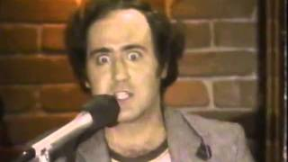 Andy Kaufman does his laundry on stage and plays the bongos