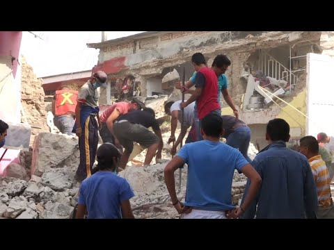 Raw: Crews Search Buildings For Quake Survivors