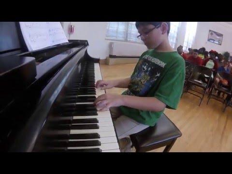 Xander Plays Piano at Claiborne Fundamental Elementary School