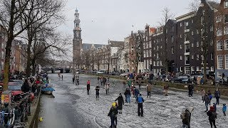 Ice skating on frozen canals in Amsterdam, Winter 2018