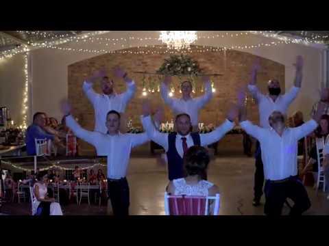 Groom surpises bride with an epic groomsmen dance!