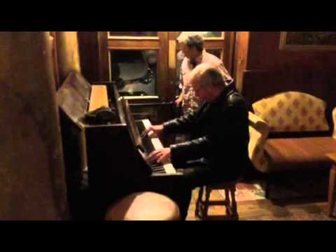 An old Irish guy plays Floyd Cramer Honky Tonk after midnight in Killarney Holiday Inn