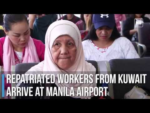 Repatriated workers from Kuwait arrive at Manila airport
