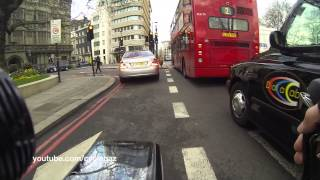 Bicycle vs Police down busy Park Lane