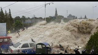 GIANT TIDAL WAVE SWEEPS AWAY SPECTATORS IN CHINA AUGUTS 23, 2013