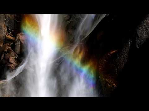 Yosemite cascading waterfalls with rainbows