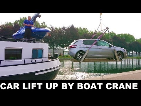 HOW DO THEY DO IT? Car lift up by boat deck crane and boarded on ship deck