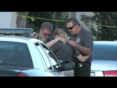 Police Officers Pray Together After Finding 2 Women, 2 Young Children, & A Baby Murdered