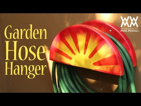Garden hose hanger. Fun spring woodworking project for your home!