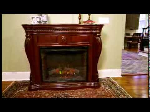 The Lexington Electric Fireplace Mantel Package by ClassicFlame is a stunningly beautiful piece of functional furniture. It features elegant carvings includi...