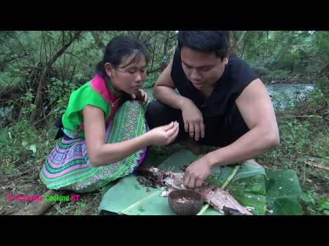 Primitive technology - Catch big fish by primitive skills and Cooking fish eating delicious