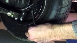 Jemal adjusting front drum brakes of a Classic Mini Cooper