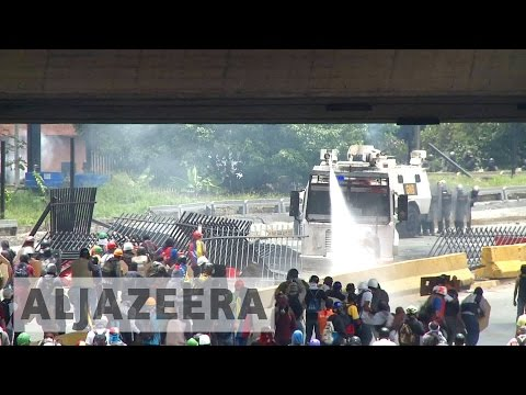 Venezuelans clash with security forces during mass protest