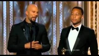 "Prince presents the award ""Best Original Song"" to John Legend and Common 