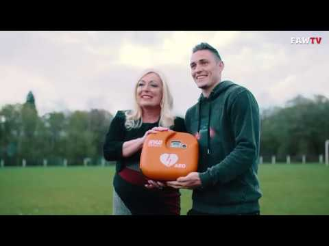 Wales defender Connor Roberts delivers Defib and training to local club